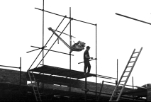 "A scaffolder erecting scaffold and a ""Barrow Hoist"" on new houses around the Newtown area. Late 60's"