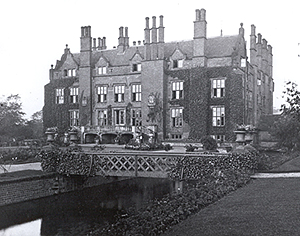 Perry Hall in the 1920s. Today, not far from the entrance to Perry Hall Playing Fields off Perry Avenue, is a rectangular garden surrounded by a brick-lined moat fed by a small stream, which runs into the nearby River Tame. Although this has every appearance of a 20th-century park feature, it is the medieval moat of Perry Hall.