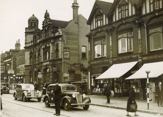 "The Red Lion Handsworth in better days, Photographed here in 1949 with locally manufactured Rover & Austin cars bought to a halt by the policeman on ""point duty""."