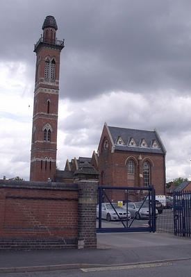 Photo 1 – Edgbaston Waterworks Tower. The buildings were designed by John Henry Chamberlain (not a relation of Joseph Chamberlain) around 1870. The engine house, boiler house, and chimney are Grade II listed buildings. Despite the close proximity to Edgbaston Reservoir there is no current or historical connection of the water. This waterworks manages domestic water supply whereas the reservoir was built to feed the canal system.