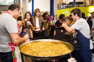 Visitors enjoying paella