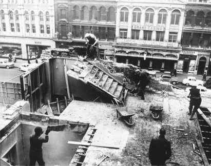 Workmen demolishing a building in Old Square in the early 1960s